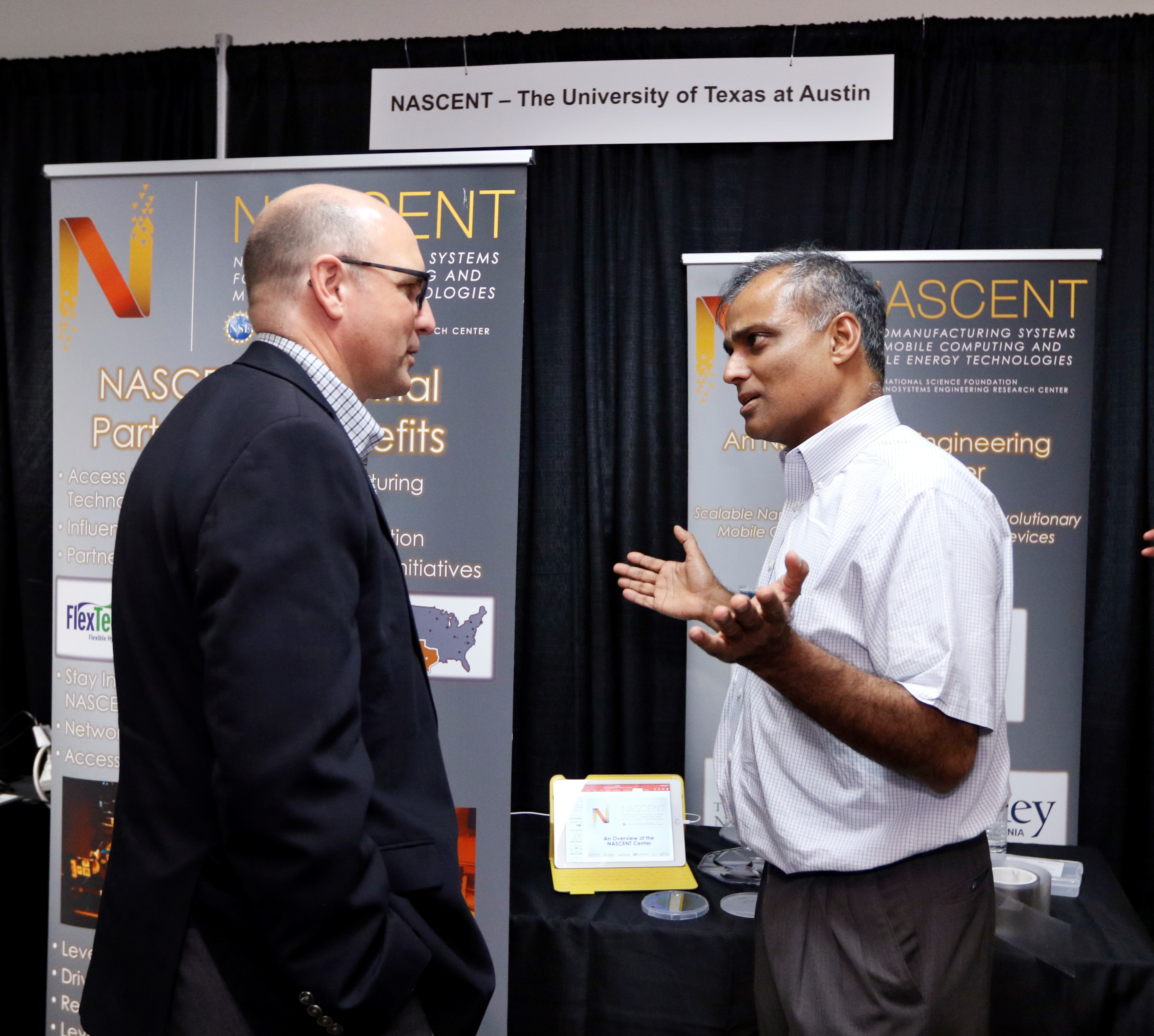 Dr. Sreenivasan in front of the NASCENT booth at NEXTFLEX Innovation Day 2018